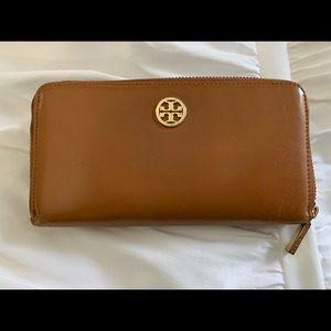 Brown Tory Burch zipper wallet